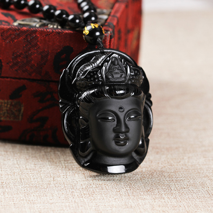 closer look to Buddha pendant on Obsidian necklace