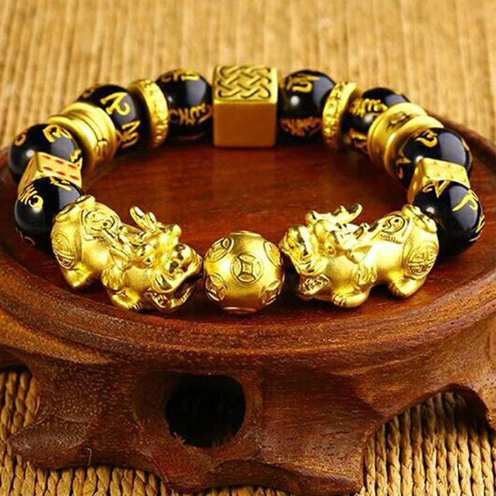 closer look to Buddhist bracelet with two golden Pixiu creatures and Obsidian stone and gold plated beads