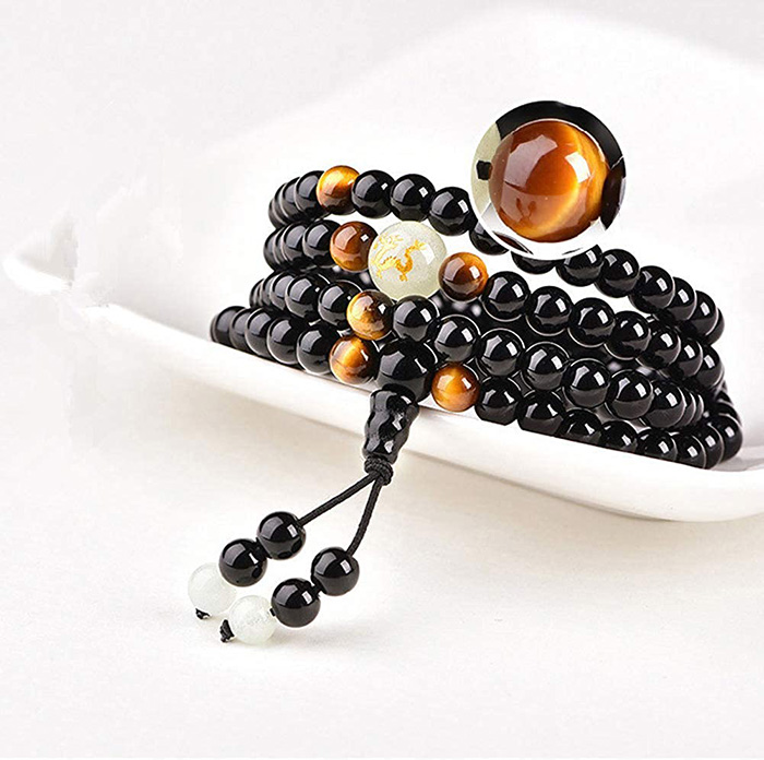 closer view to Tiger Eye stone on Buddhist mala bracelet