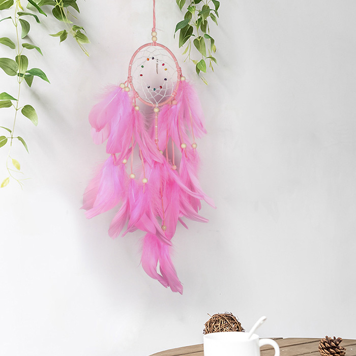 pink dream catcher hanging on the wall