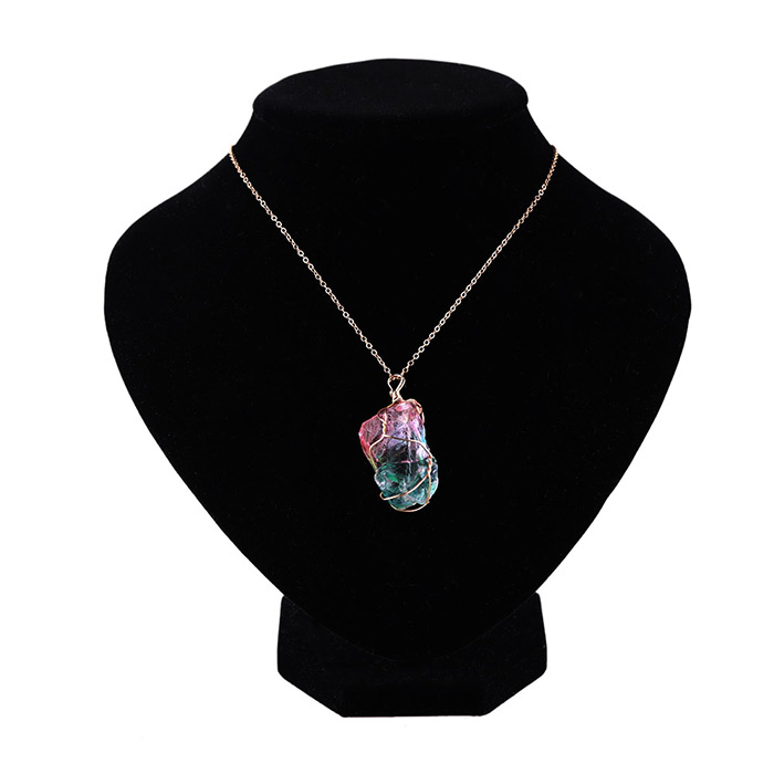 rainbow stone pandant necklace around doll neck