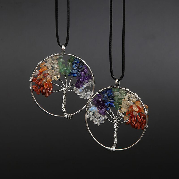 two pendants with tree of life symbol and chakra color stones