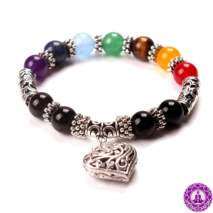 woman bracelet with natural stones in seven chakras colors and heart pendant