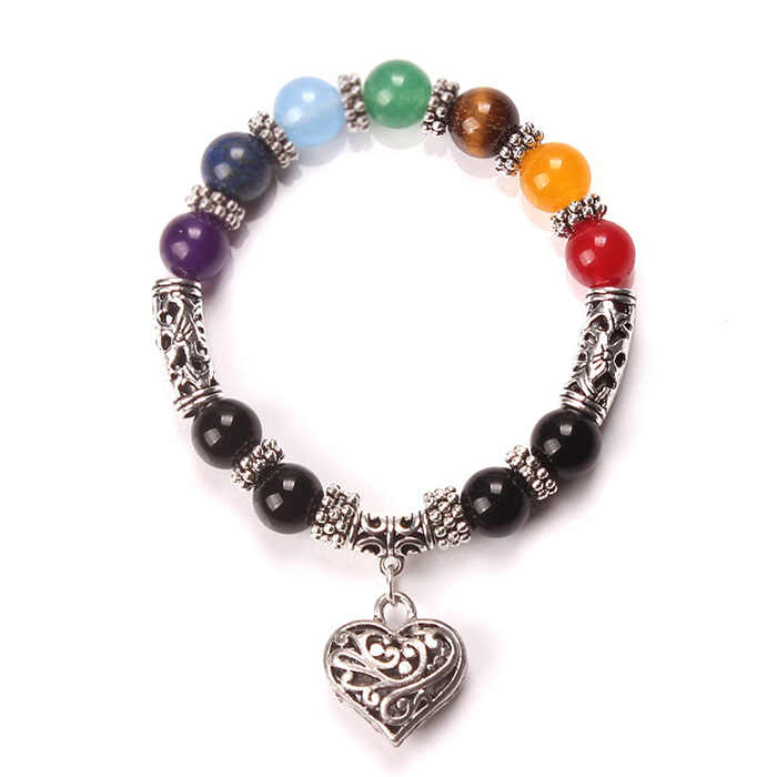 woman bracelet with seven chakras healing stones and heart pendant