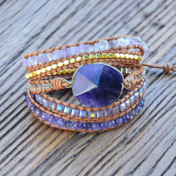woman wrap bracelet with large Amethyst stone on a wooden desk