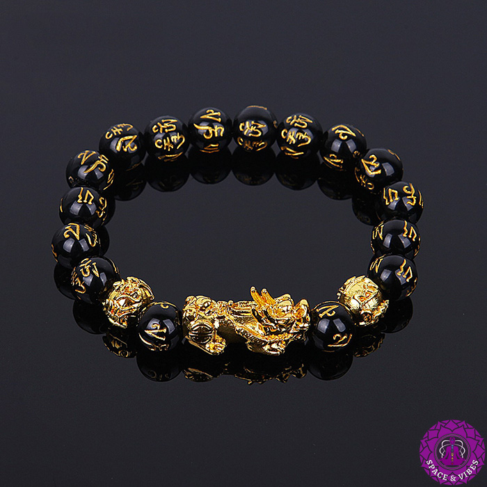 Feng Shui wealth bracelet and Pixiu pendant on a black background