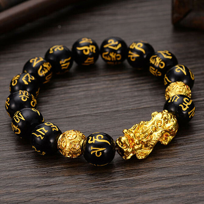 Pi Yao wealth bracelet laid on a desk
