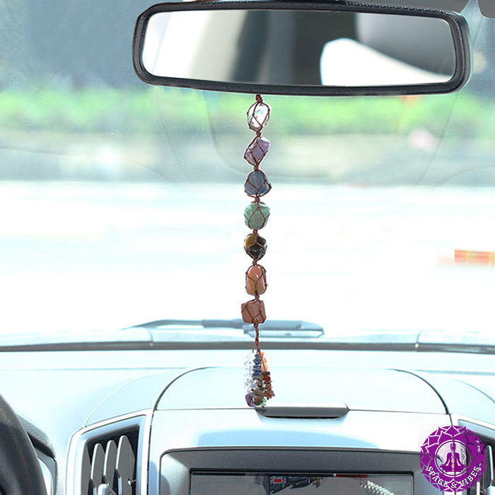 chakra color natural stones hanging in the car on a rearview mirror