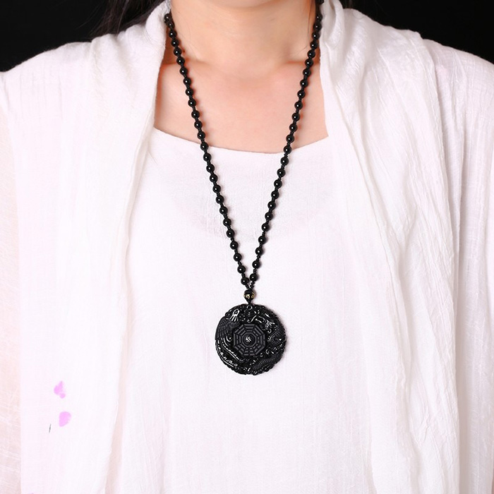 man wearing Black Obsidian dragon and phoenix lucky necklace