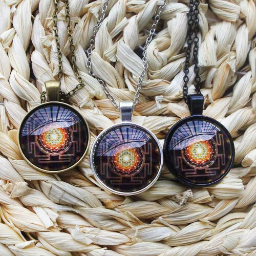 three Sri Yantra necklaces with different metal colors