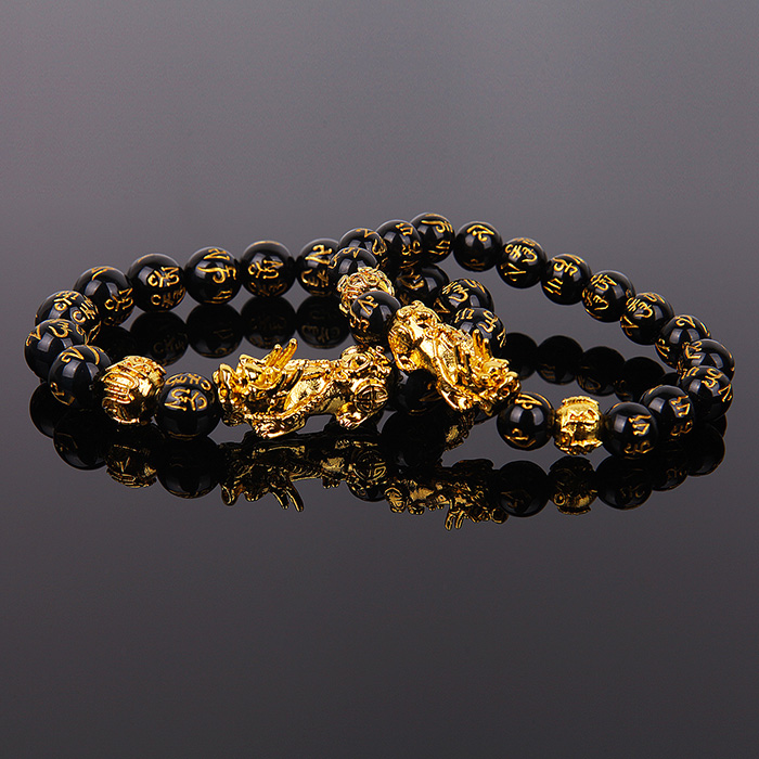 two Feng Shui Obsidian bracelet leaning on one another