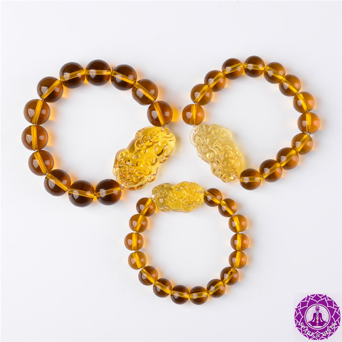 upper view on a three different sizes of Citrine Pixiu wealth bracelet