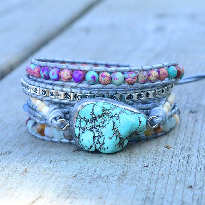woman warp bracelet with large Turquoise stone