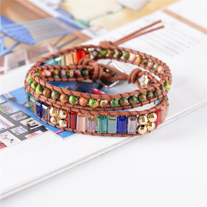 wrap bracelet with crystal stones in seven chakra colors laid on magazine