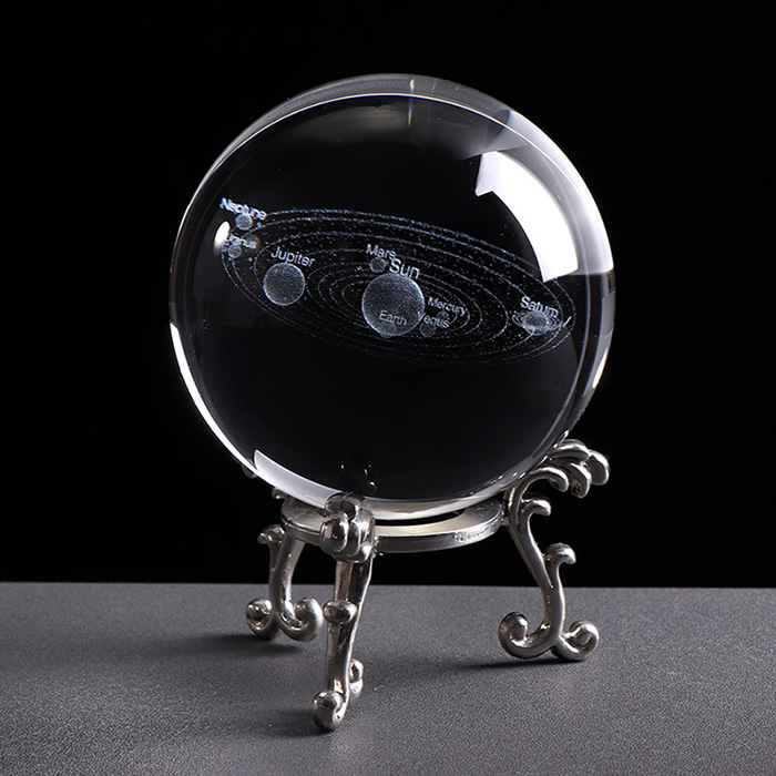 3D solar system ball made of glass on a silver color stand