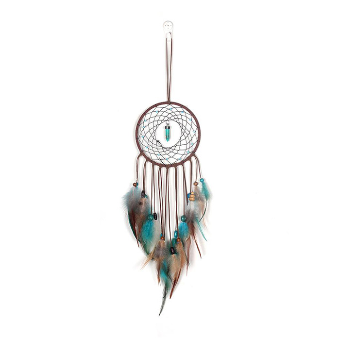 dream catcher with the crystal in the middle of its net laid on a white background