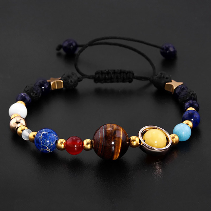 solar system energy bracelet on the black background