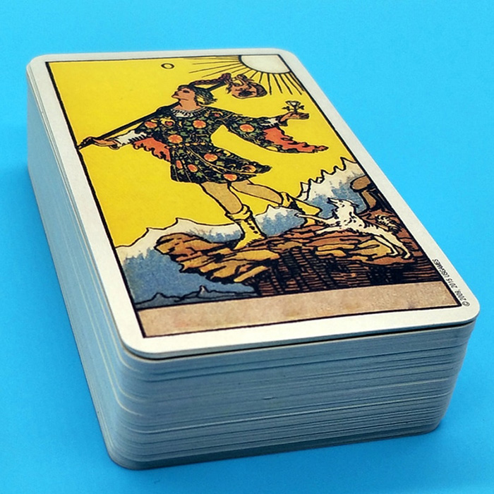 white tarot card deck on a blue background