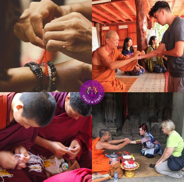 Buddhist monks give red string bracelet to believers