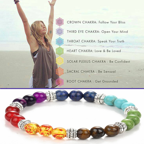 woman doing yoga and seven chakra bracelet