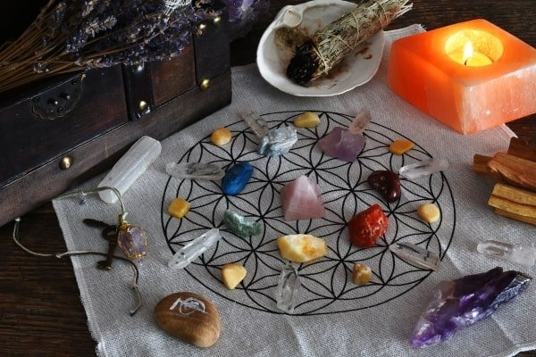 chakra stones positioned on a crystal grid